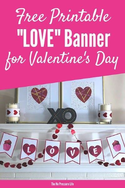 Free printable LOVE banner for Valentine's Day hanging on a mantel