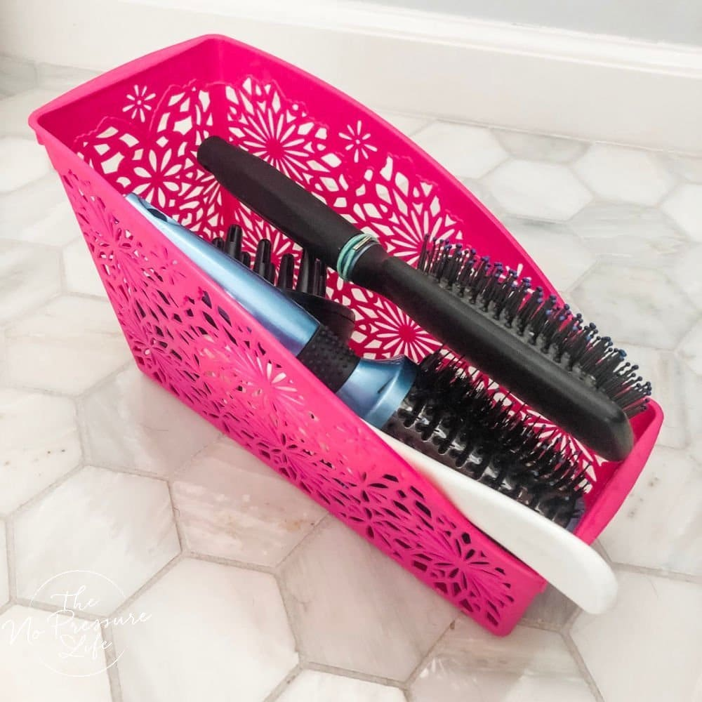 Organized hair brushes and combs in a bathroom