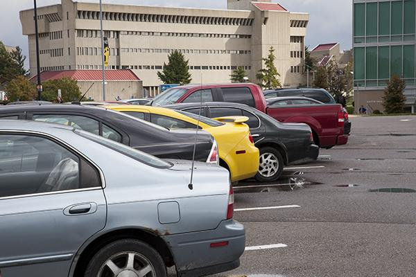 Cars in a parking lot across from Griffin Hall. Many students say that having the right car can save you money at the gas pump.