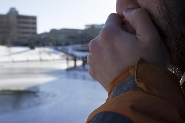 "Throughout the polar blast, students found ways to handle the low temperatures on their walks across campus. ""I wear a hat all the time,"" Alexus Berns, a senior creative writing major, said. ""My nose is constantly runny. I can't feel my face and I feel like I don't have a nose."""