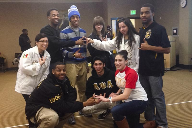 Members of Alpha Psi Lambda National, Inc. and Alpha Phi Alpha Fraternity Inc. together at the Colors of Love event.