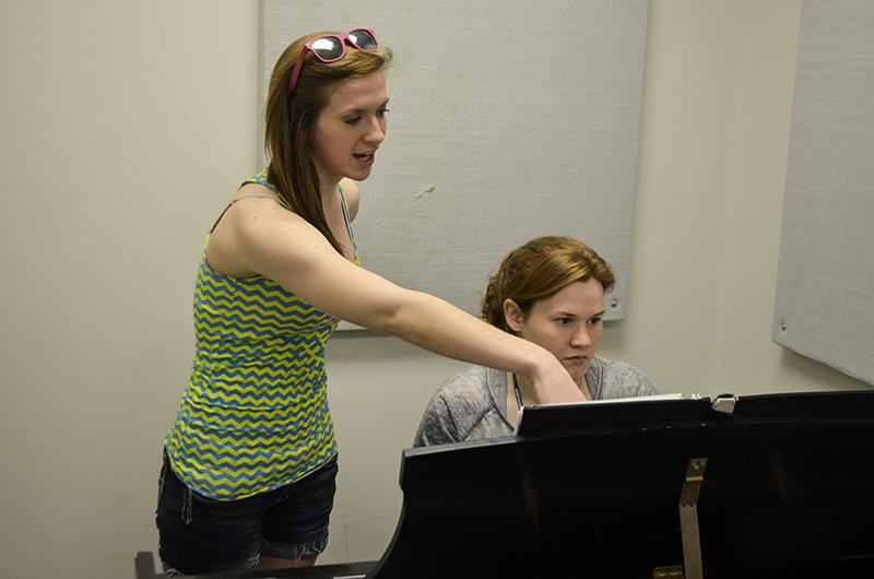 Freshmen+theatre+majors+Kristen+Schisler+and+Lauren+Frizzell+practice+singing+and+playing+piano+together.+