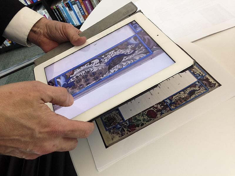 Kirby+demonstrates+an+iPad+based+teaching+tool+developed+by+English+professor+Tamara+O%27Callaghan.+The+tool%2C+used+for+her+Middle+English+course%2C++uses+the+iPad%27s+camera+function+to+scan+art+based+QR+codes%2C++and+provide+context+to+student%27s+reading.+