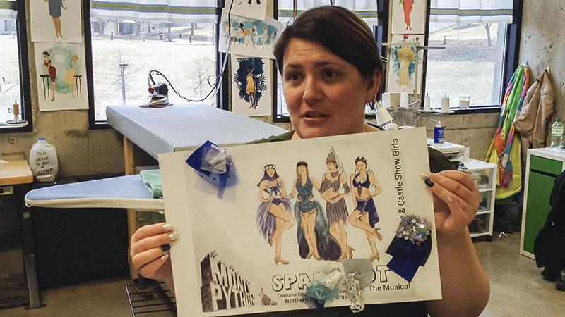 Ronnie Chamberlin holds up one of the designs for a Spamalot costume.