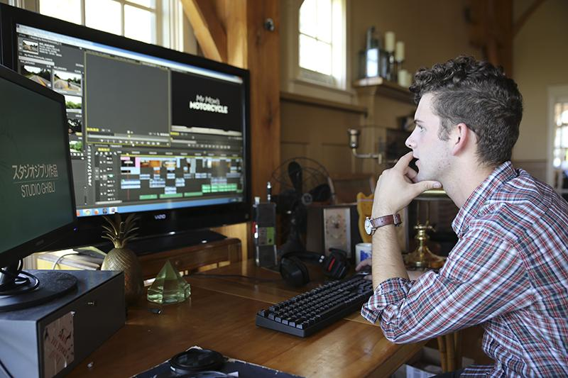 Gautraud sits at the work station where he edited together the footage that would become 'My Mom's Motorcycle'. Sitting on his desk are several of the sentimental items featured in the short film.