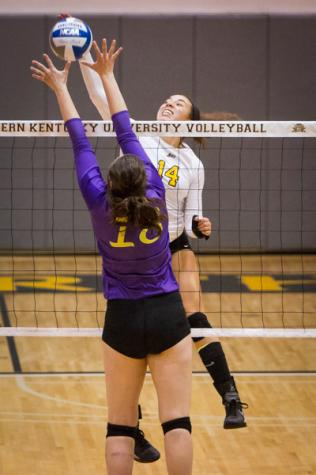 NKU's Keely Creamer kills the ball against Lipscomb in NKU's come from behind win. NKU defeated Lipscomb 3-2 at Regents Hall on Friday, Oct. 24, 2014.