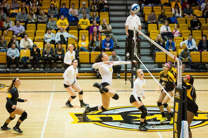 NKU%27s+Keely+Creamer+jumps+up+to+kill+the+ball+across+the+net+during+NKU%27s+3-0+victory+over+Kennesaw+St.+NKU+defeated+Kennesaw+State+3-0+at+Regents+Hall+on+NKU+Campus+on+Nov.+14%2C+2014.