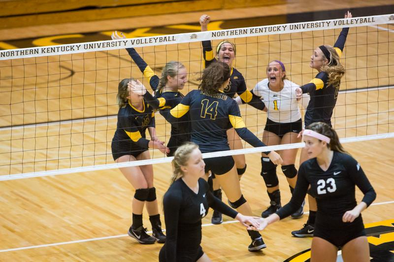 NKU%27s+volleyball+team+celebrates+after+a+NKU+point+against+Stetson+in+the+third+set+of+NKU%27s+3-0+win+against+the+Hatters.+NKU+defeated+Stetson+3-0+at+Regents+Hall+on+NKU+Campus+on+Saturday%2C+Nov.+1%2C+2014.