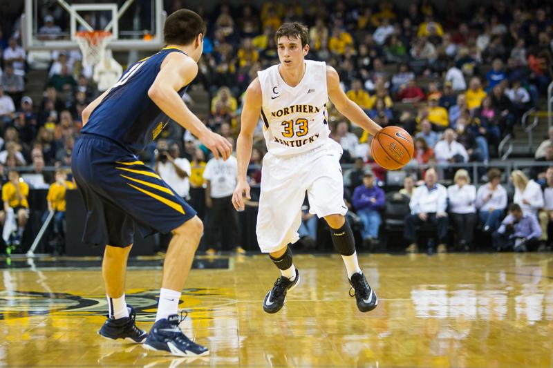NKU men's basketball player Anthony Monaco faces a defender during the first half of NKU's 42-67 loss to West Virginia University. NKU was defeated by West Virginia University 42-67 at The Bank of Kentucky Center on Sunday, Dec. 7, 2014.