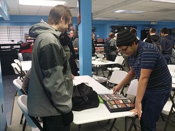 Dan Gerhardt (left) and Tony Miorano (right) trade cards in between rounds.