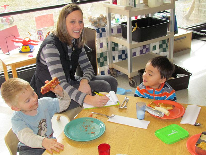 Audrey Wilson works with some of the students at the Early Childhood Center.
