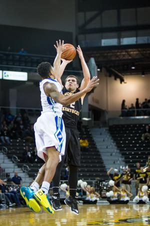 NKU guard Tayler Persons shoots the ball during the second half of NKU's 59-65 loss to FGCU. NKU lost to Florida Gulf Coast 59-65 at The Bank of Kentucky Center on Thursday, Feb. 12, 2015.