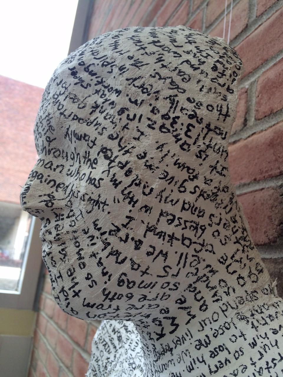Abby Schlachter's cast covered in writing on display at the festival.