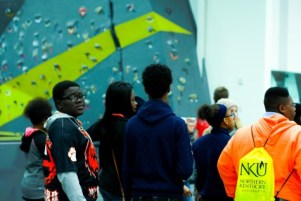 Students explore the new Campus Recreation Center, pictured here in front of the bouldering wall.