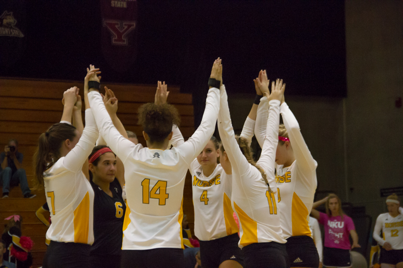 The+Norse+volleyball+team+raises+their+hands+in+celebration+after+scoring+a+point.+Creamer+%2814%29+won+Horizon+League+Offensive+Player+of+the+Week+while+Lauren+Hurley+%286%29+won+Defensive+Player+of+the+Week.