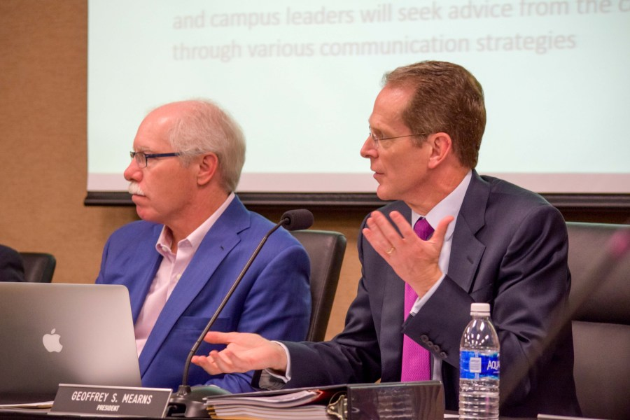 NKU President Geoffrey Mearns (right)  and Rich Boehne during a recent Board of Regents meeting.
