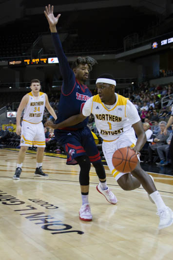 Jordan Garnett dribbles down the baseline against a Detroit Mercy defender. The Norse would beat the Titans 101-87