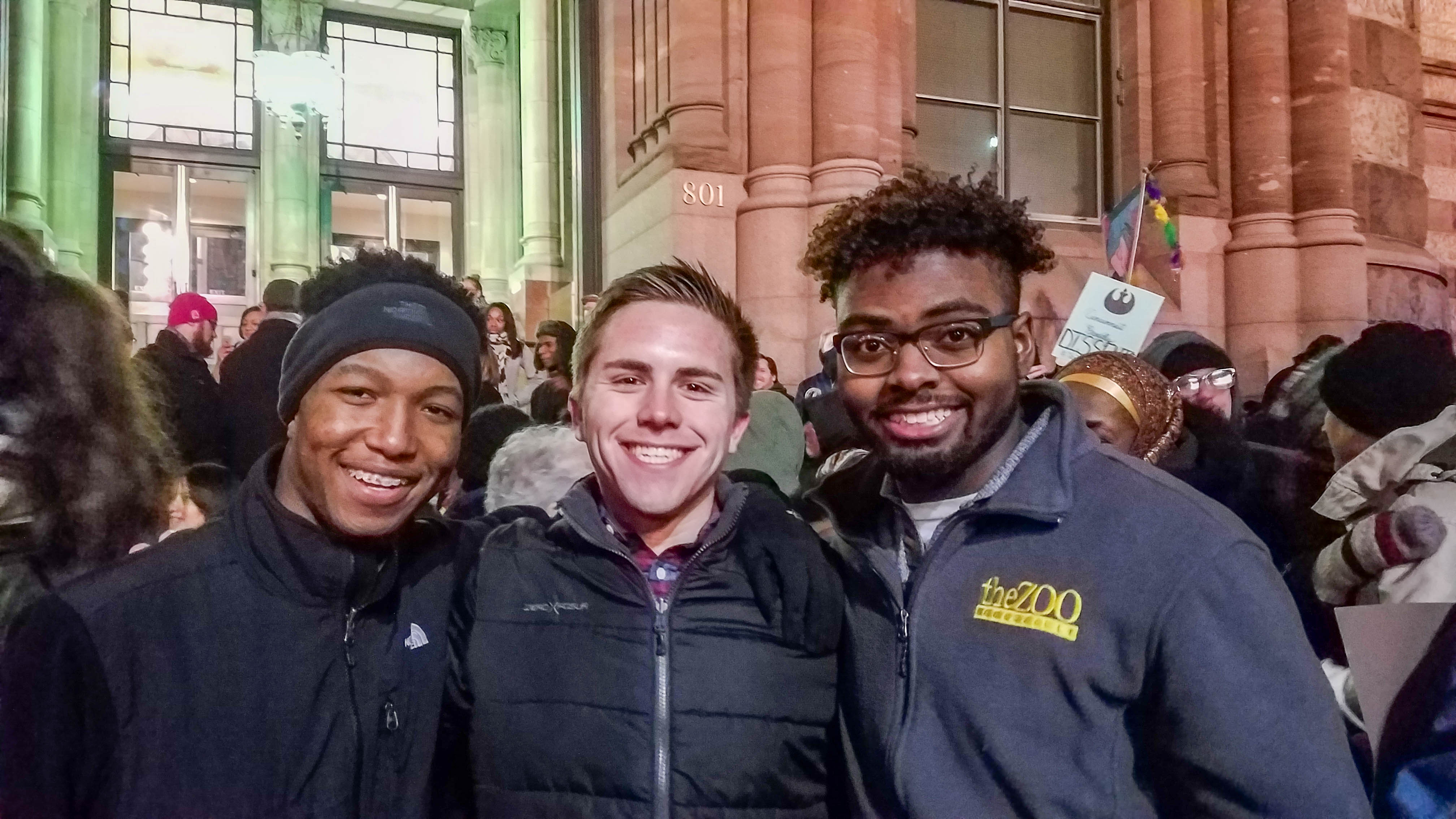 NKU student Sami Dada, Michael Bailey and Patrick Edwards attend Monday's rally in Cincinnati protesting President Donald Trump's executive order temporarily limiting immigration from certain countries.