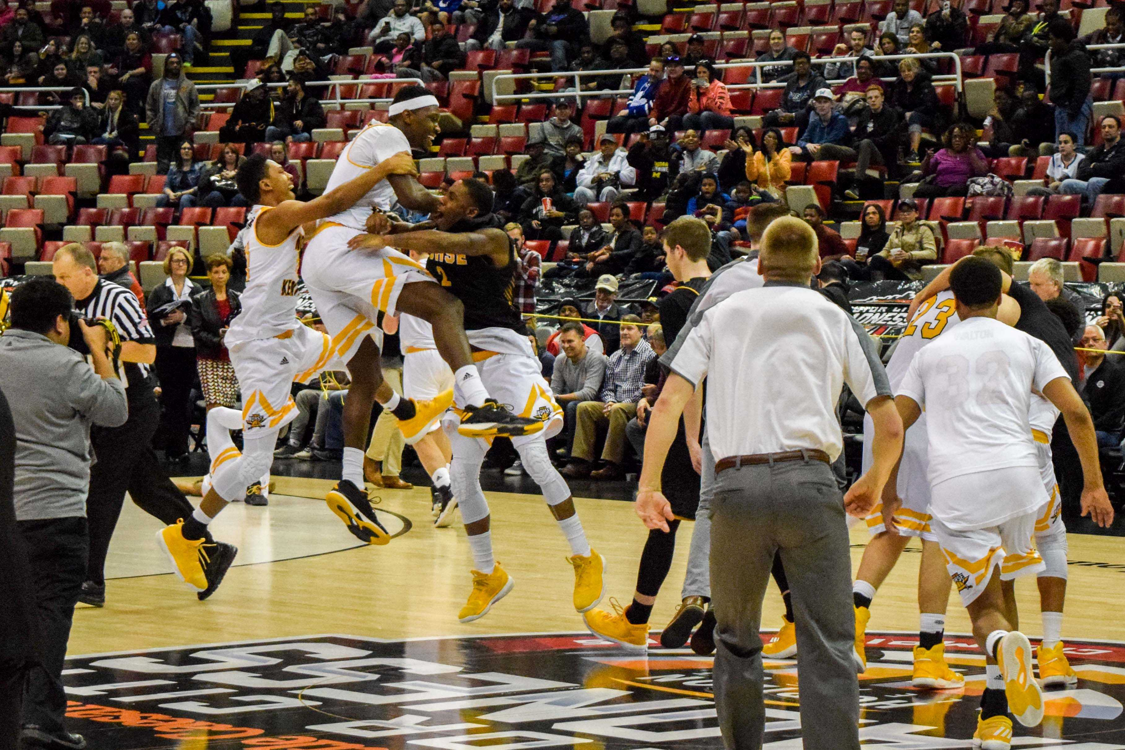 The NKU men's basketball team celebrates after winning the Horizon League championship.