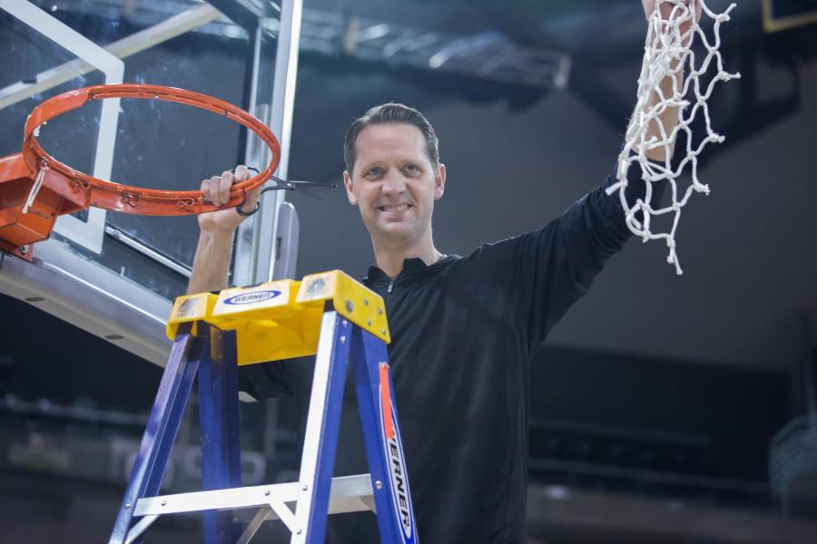 Head+Coach+John+Brannen+holds+up+the+net+to+the+spectators+in+BB%26T+Arena.
