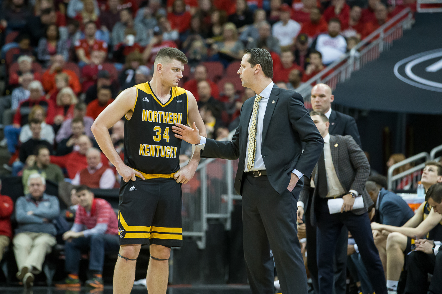 Drew McDonald (34) talks to Head Coach John Brannen during a freethrow during the game against Louisville.
