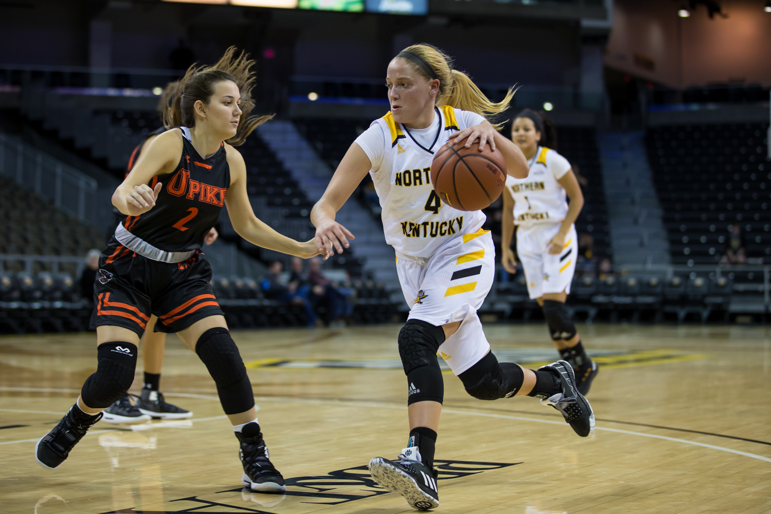 Taylor Clos (4) drives toward the basket during the game against University of Pikeville.