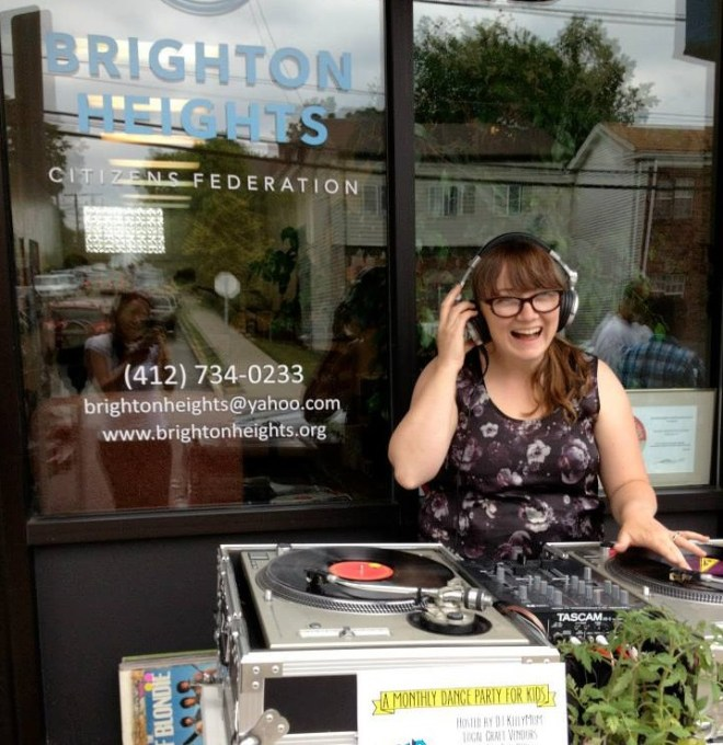 Brighton Heights resident Kelly Day was there to DJ.