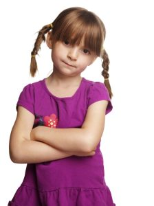 Cute  little girl with braided pig tails and arms crossed with f