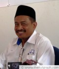 BN candidate Abdul Aziz Yusof appears more amiable compared to PAS's candidate