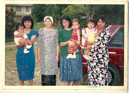 Yuna (second child from right) with her mother and aunts.