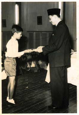 Zaid receiving a prize when he was in Standard 6