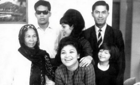 Liyana (bottom right), with her mother (middle, back), her maternal grandmother (front, centre) and other family members in an old photo from the 70s.
