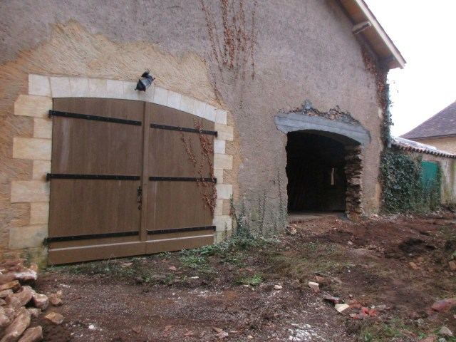 Here's the second garage opening to create a 2 (or more) car garage [can you guess that Theo's looking???]