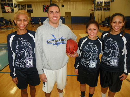 Photo by Jim HagueThe Harrison girls' basketball team is off to a fine 4-2 start, including winning the championship at the Wallkill Valley Christmas Tournament. From l. are Rayven Lucas, head coach Al Diaz, Yulissa Pereyra and Sarai Rivera.