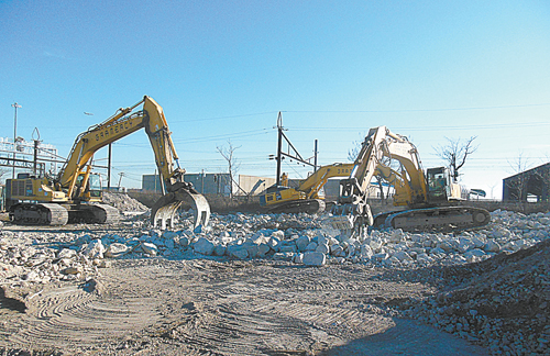 Photos courtesy of Heller Industrial ParksAnd then, all that was left was the clean-up, as construction equipment (resembling alien creatures) gnawed at the building remnants.