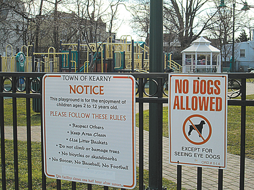 Photo by Ron LeirSign warns that dogs aren't allowed in the playground.