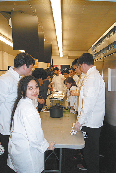 Photo by Karen Zautyk Kearny High culinary arts students in school kitchen predinner.