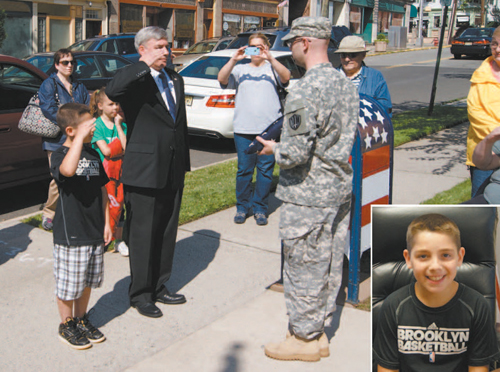 Photo by Karen Zautyk Public Affairs Commissioner Steven Rogers and Commissioner-for-a-Day Brian Conte (in inset) accept 'retired' flag.