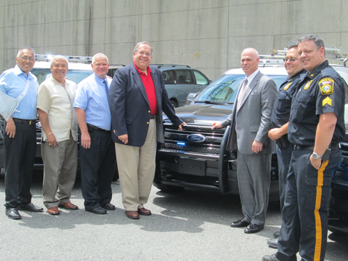 Photos by Ron Leir Checking out the new police cars, from l., are Town Councilmen Victor Villalta, Jesus Huaranga and James Doran, Mayor Ray McDonough, Police Chief Derek Kearns, Sgt. David Strumolo and Sgt. Rich Lourenco.