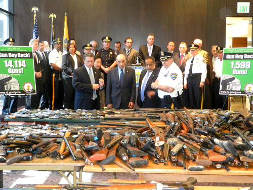 Photo courtesy nj.gov Guns collected in Hudson County are displayed by law enforcement agents.