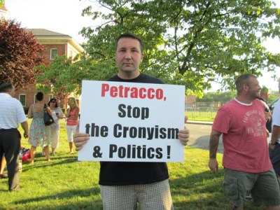 Photos by Ron Leir Demonstrators outside Nutley Municipal Building at rally sponsored by township's PBA local.