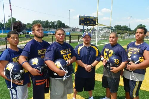 Photo by Jim Hague The Belleville High School football team will be much improved this season, if the offensive line has anything to say about it. From l. are Chris Figueroa, Nick Nardachone, head coach John Dubuque, Jose Gonzalez, Johnny Ramirez and Joshua Marte.