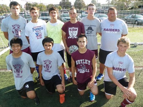 Photo by Jim Hague The Nutley boys' soccer team will try to defend the SEC divisional title they won a year ago. Front row, from l., are Yoshio Ishikawa, Tommy Melillo, Anthony DeBlasio and Jack Contini. Back row, from left, are Nick Feraco, Domenic Palumbo, Santino Gabriele, Joseph Nichols, Will Montgomery and head coach Marcellino Marra.