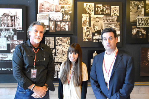 Photo by Jack Grimm Teacher Gary DiVincenzo (l.), senior Shannon Stoia and Principal Al Gilson and the newly decorated photo wall.