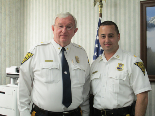 Photo by Ron Leir Chief John Holland (l.) and Capt. Tom Strumolo in the chief's office last week.