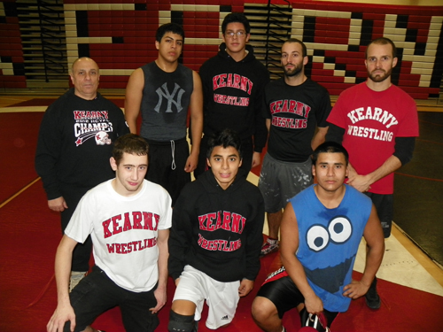 Photo by Jim Hague The Kearny High School wrestling team is experiencing some growing pains. Front row, from l., are James Hodnet, Wilker Villacorta and Luis Cornejo. Back row, from l., are head coach Tony Carratura, Giovanni Diaz, Johann Holguin, assistant coach Brian McDonnell and assistant coach Rich Stacey.