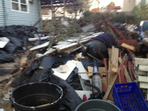 Photo  courtesy Kearny DPW Piles of debris collected at 144 Kearny Ave.;