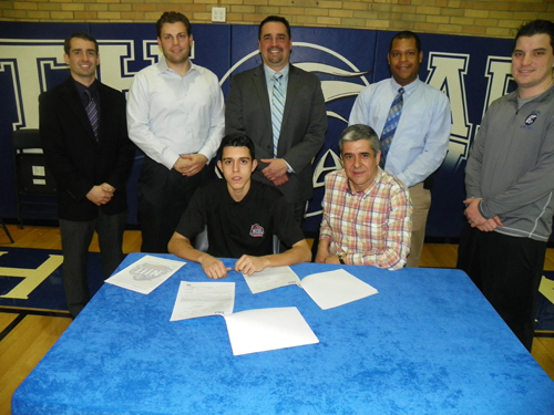 Photo by Jim Hague North Arlington senior Danny Cordeiro (seated l.), flanked by his dad, Carlos Cordeiro, signs his national letter of intent to attend the New Jersey Institute of Technology and play soccer at the Newark school in the fall. Standing, from l., are: Vice Principal Dennis Kenny, Head Soccer Coach Jesse Dombowski, Principal Lou Manuppelli, Athletic Director Dave Hutchinson and Track and Field Coach Joe Cioffi.