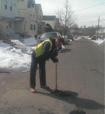 Photo courtesy Kearny DPW DPW employee Brian Paul applies fi nishing touches to pothole on Davis Ave. near Laurel Ave.