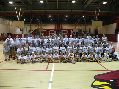 Photo by Jim Hague The entire group of young ladies who participated in the Kearny High School girls' basketball camp pose with head coach and head instructor Jody Hill (c.).